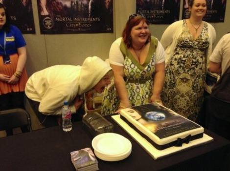 Jamie Campbell Bower and Cassandra Clare with a Mortal Instruments cake