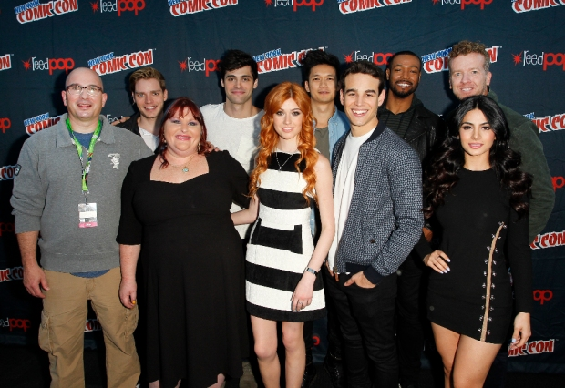 "SHADOWHUNTERS - The cast and creators of ABC Family's ""Shadowhunters"" appear at New York Comic-Con on October 10, 2015 to discuss the new series. ""Shadowhunters"" premieres Tuesday, Jan. 12 at 9 p.m. ET on ABC Family. (ABC Family/Lou Rocco) ED DECTER, DOMINIC SHERWOOD, CASSANDRA CLARE, MATTHEW DADDARIO, KATHERINE MCNAMARA, HARRY SHUM JR., ALBERTO ROSENDE, ISAIAH MUSTAFA, MCG, EMERAUDE TOUBIA"