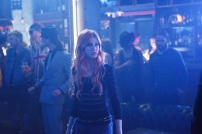 """SHADOWHUNTERS - """"The Mortal Cup"""" - One young woman realizes how dark the city can really be when she learns the truth about her past in the series premiere of """"Shadowhunters"""" on Tuesday, January 12th at 9:00 - 10:00 PM ET/PT. ABC Family is becoming Freeform in January 2016. Based on the bestselling young adult fantasy book series The Mortal Instruments by Cassandra Clare, """"Shadowhunters"""" follows Clary Fray, who finds out on her birthday that she is not who she thinks she is but rather comes from a long line of Shadowhunters - human-angel hybrids who hunt down demons. Now thrown into the world of demon hunting after her mother is kidnapped, Clary must rely on the mysterious Jace and his fellow Shadowhunters Isabelle and Alec to navigate this new dark world. With her best friend Simon in tow, Clary must now live among faeries, warlocks, vampires and werewolves to find answers that could help her find her mother. Nothing is as it seems, including her close family friend Luke who knows more than he is letting on, as well as the enigmatic warlock Magnus Bane who could hold the key to unlocking Clary's past. (ABC Family/John Medland) KATHERINE MCNAMARA"""