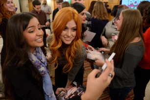 SHADOWHUNTERS - 12/5/15 - Eleven lucky SHADOWHUNTERS fans and their guests were flown from around the country to meet author Cassandra Clare and the cast of the ABC Family series during a Pop-Up Santa surprise in New York City. ABC FAMILY is becoming FREEFORM in January 2016. (ABC FAMILY/ Lorenzo Bevilaqua) KATHERINE MCNAMARA, FANS
