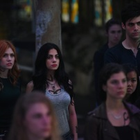 "SHADOWHUNTERS - Clary struggles to find where she belongs, while Simon seeks Magnus' help in ""A Door Into the Dark,"" an all new episode of ""Shadowhunters,"" airing MONDAY, JANUARY 9 (8:00 – 9:00 PM EDT) on Freeform. (Freeform/John Medland) KATHERINE MCNAMARA, EMERAUDE TOUBIA, MATTHEW DADDARIO"